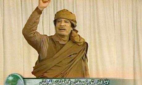 Libyan leader Muammar Gaddafi gestures during a rally on 19 February 2011