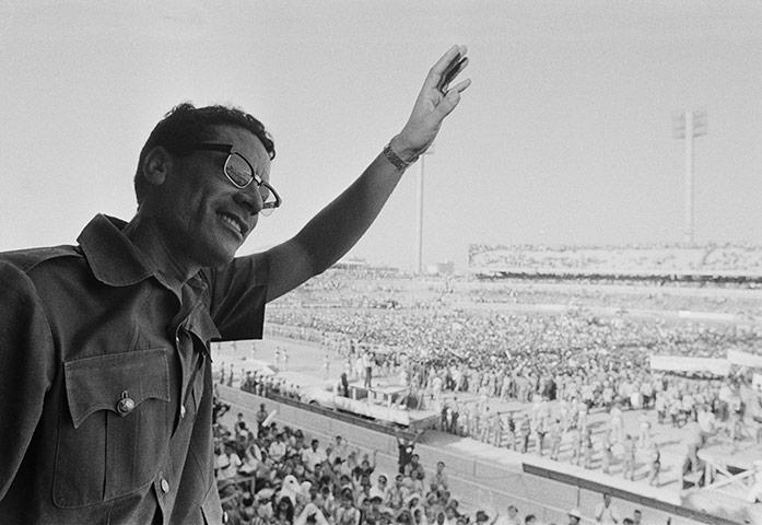 Muammar Gaddafi : July 1973: Muammar Gaddafi waves to demonstrators gathered in Benghazi