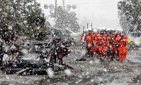 Rescue workers in Sendai, Japan