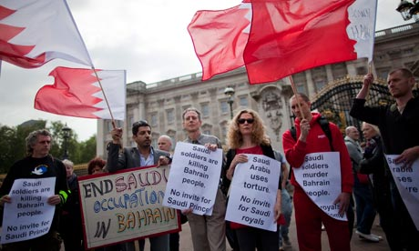 Protesters at Buckingham Palace in London demonstrate against Bahrain's prescence at the royal wedding. The crown prince is to stay away but the ambassador is still planning to attend. Photograph: Ian Langsdon/EPA