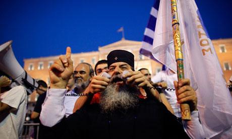 Greek Orthodox monk speaks to protesters
