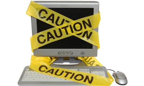 Caution Tape on Computer