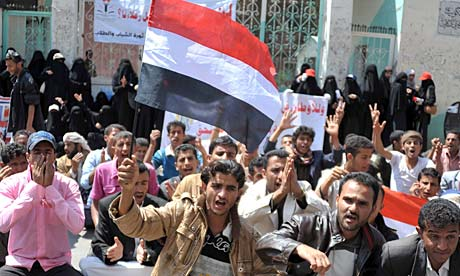 Yemeni protesters rally outside of Sanaa University (Photo courtesy of The Guardian).