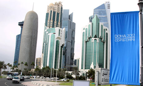 Conference flags are displayed ahead of the Doha climate change conference