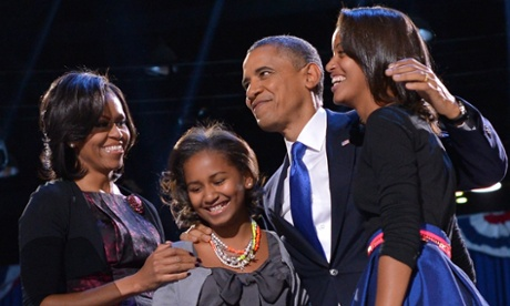 US President Barack Obama accompanied by First Lady Michelle and daughters Sasha and Malia appears on stage on election night.