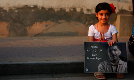 A girl holds a poster calling for the release of Nabeel Rajab in Bahrain. Photograph: Ammar Photography/Demotix/Corbis