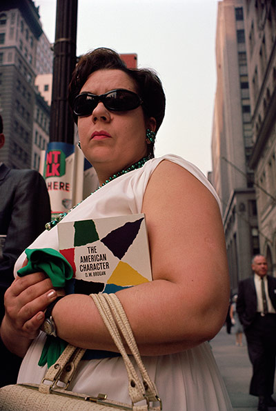 Joel Meyerowitz Monograph: A colour shot of woman from sixties from waist level