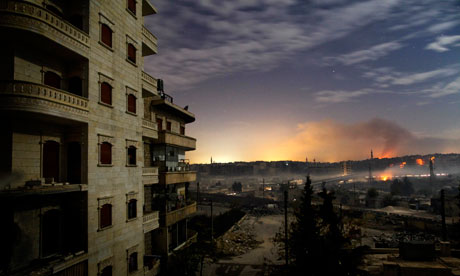 Smoke rises in the Hanano and Bustan al-Basha districts in the northern city of Aleppo