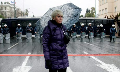 A demonstrator outside the Parliament in Athens