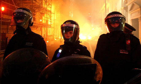 Riot police are seen in front of fires during a demonstration against government spending cuts in London. Photograph: Dominic Lipinski/PA Archive/PA Ima