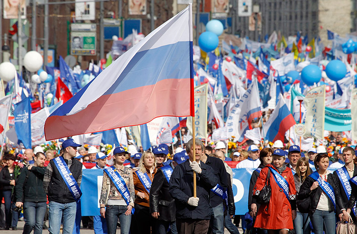 May Day 2012: Moscow: A participant carries the Russian national flag