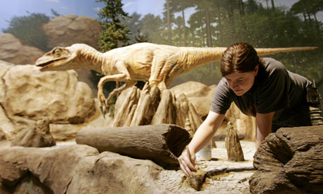 An artist works on an exhibit at The Creation Museum