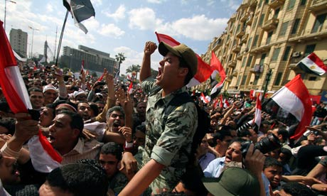 An Egyptian army officer chants slogans during a rally in Cairo