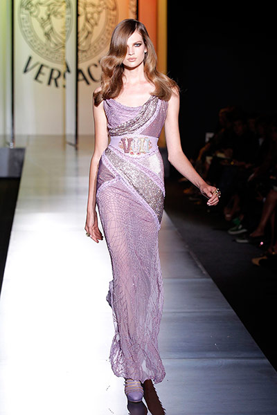 Versace guests: A model presents a creation by Versace