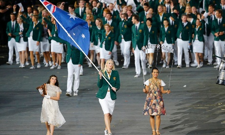 Australia's flag bearer Lauren Jackson holds the national flag as she leads the contingent in the athletes parade during the opening ceremony of the London 2012 Olympic Games