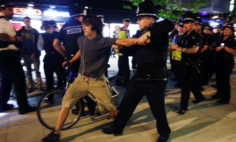 A cyclist is arrested after a Critical Mass bike protest outside the Olympic Park during the 2012 Summer Olympics Opening Ceremony