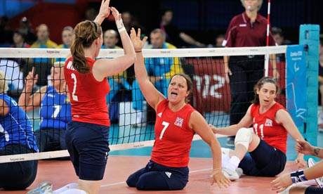 Martine Wright celebrates a point with Victoria Widdup in their Paralympics match against Ukraine