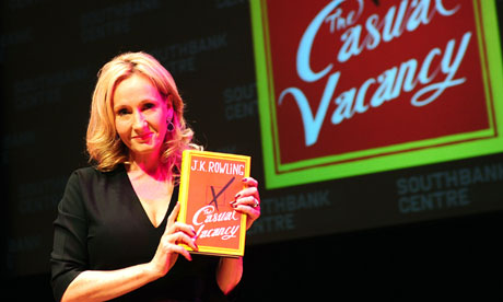 JK Rowling holding a copy of The Casual Vacancy