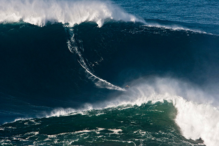 Garrett McNamara : Garrett McNamara surfs at the Praia do Norte beach in Nazare, Portugal 2011