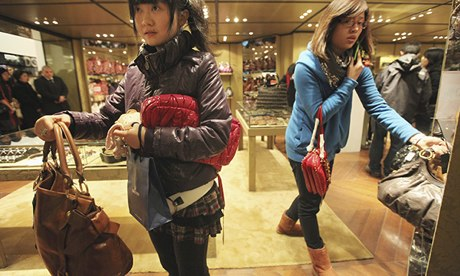 Handbags on sale in a department store