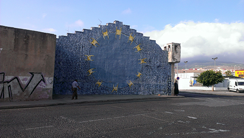 A mural based on the EU flag adorns a wall in Melilla