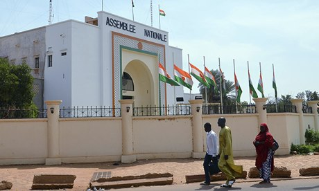 Flags fly at half mast in Niamey, the capital of Niger, in memory of 92 who died in Sahara