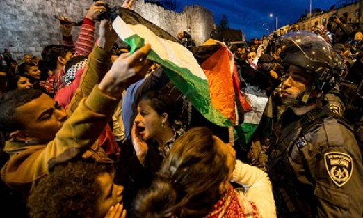 Protesters shout slogans in front of Herod's Gate, Jerusalem, in support of Bedouin Arabs