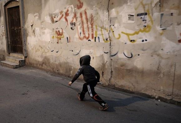 20 photos: A Bahraini boy holds a used tear gas canister