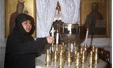 (FILES) A Syrian nun lights candles insi