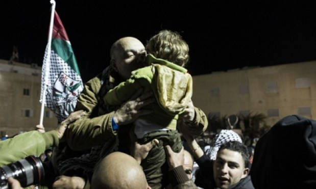Palestinian families greet freed prisoners as they arrive at the Mukata presidential compound in Ramallah