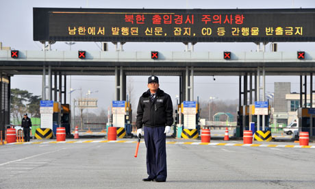 A South Korean security guards the road leading to the Kaesong complex in Paju