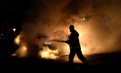 Firemen extinguish a burning car in Kist