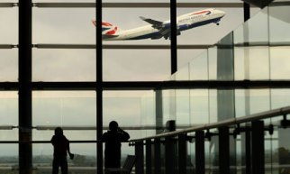 A British Airways passenger jet takes of at Heathrow airport