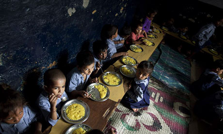 Children eat school meals at a New Delhi