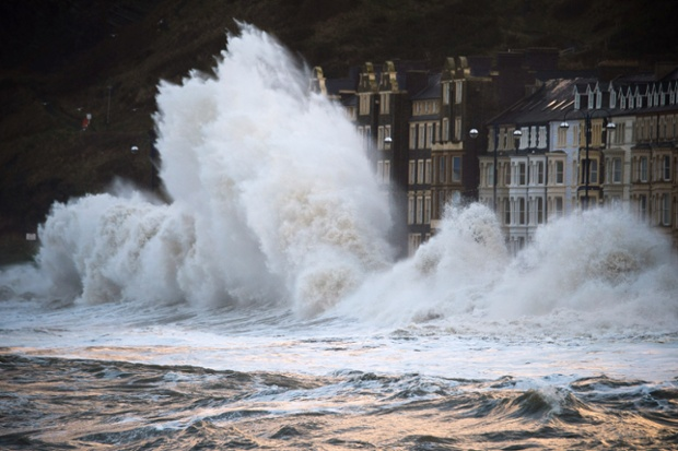 A 5.6m high springtide and gale force south westerly winds cause massive waves to pound against the promenade and harbour in Aberystwyth, Wales. The entire promenade was closed to traffic by 8am due to safety fears.