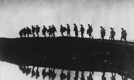 Supporting troops of the 1st Australian Division walking on a duckboard track near Hooge in Ypres. Photograph: Frank Hurley/Getty Images