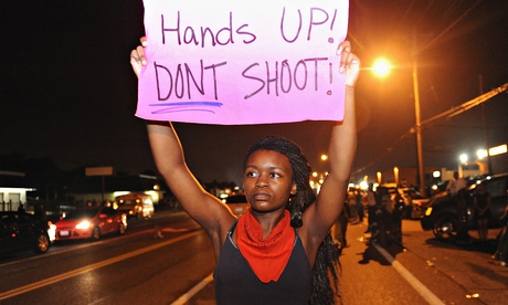 Protestors hold signs in Ferguson