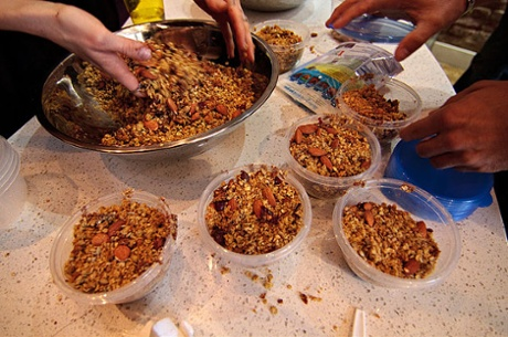 Cannabis-infused trail mix is put into containers for participants in a cannabis cooking class in Denver, Colorado.