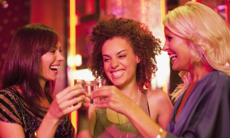 women drinking shots