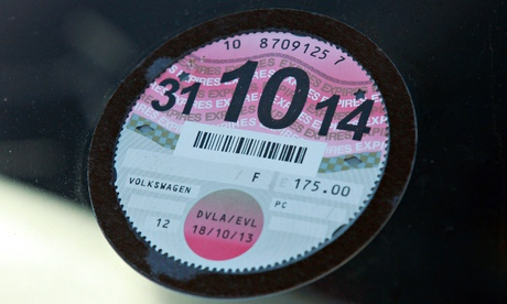 A car tax disc: on the way out. Photograph: PA