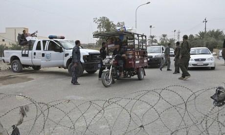 Iraqi security forces guard a checkpoint in Ramadi, Anbar province.
