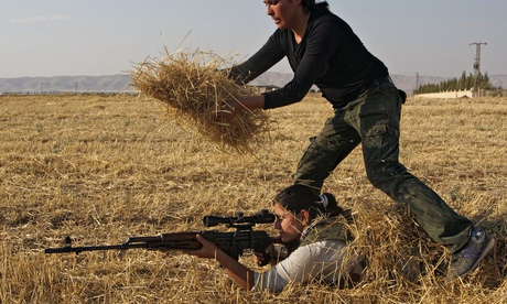 A Young Syrian-Kurdish woman hides a par