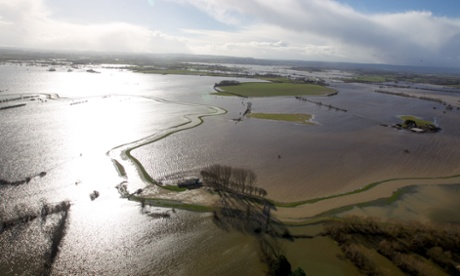Water surrounding flooded properties on the Somerset Levels near Bridgwater as a study by the European Environment Agency (EEA) has found that extreme weather conditions such as floods and heatwaves are pushing countries across Europe into taking action to adapt to a changing climate.