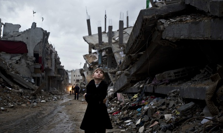 Palestinian boy in ruined part of Gaza