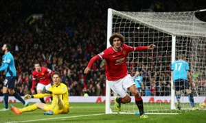 Marouane Fellaini celebrates after scoring the first goal for Manchester United.