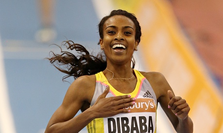 Genzebe Dibaba celebrates winning the women's two-mile contest at Birmingham's indoor grand prix