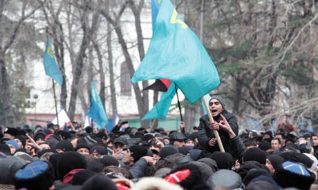 Nationalist Crimean tatars wave blue flags as they gather in Simferopol on Wednesday.