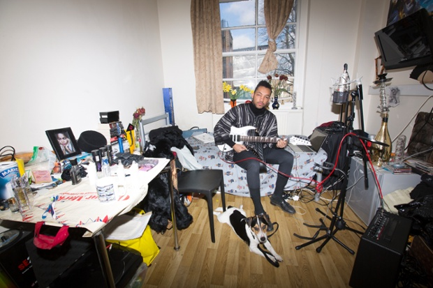 Usman 'Uzzee' Rabiu in his bedroom in London.