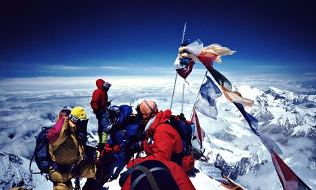 Climbers on summit of Mount Everest. Long, angry queues can form at peak season with two hour waits