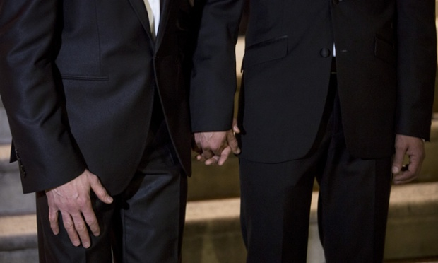 Peter McGraith and David Cabreza, who have been partners for 17 years, hold hands outside Islington Town Hall before their wedding.